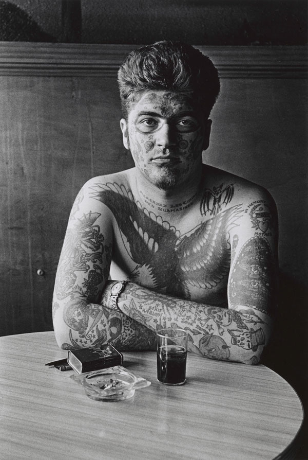 Diane Arbus, Jack Dracula at a bar, New London, Conn © The Estate of Diane Arbus, LLC. All rights reserved.