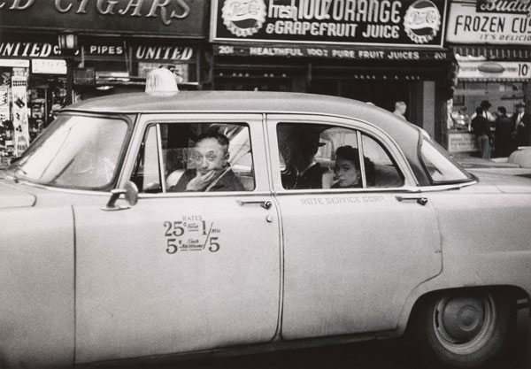 Diane Arbus, Taxicab driver at the wheel with two passengers, N.Y.C © The Estate of Diane Arbus, LLC. All rights reserved.